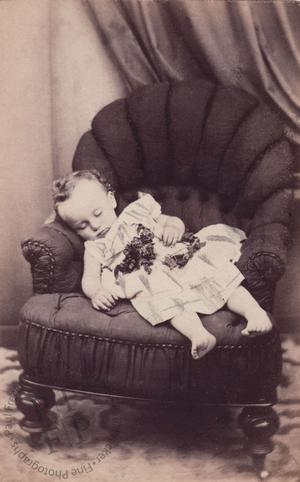 Bare-footed child on an armchair