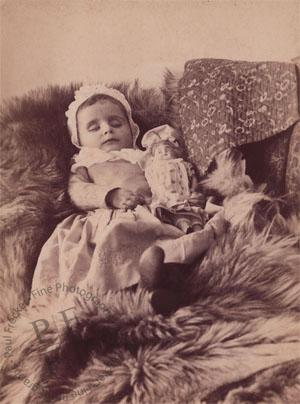 Small girl with a doll